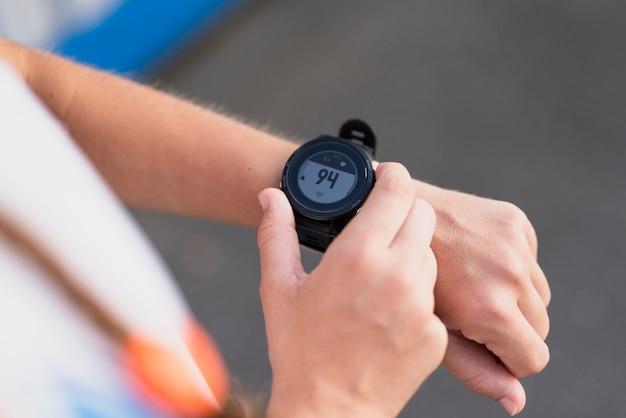 High angle sportive checking time Free Photo