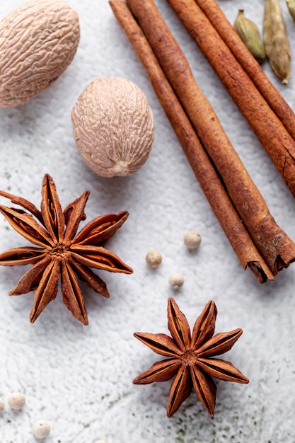 High angle of star anise and nutmeg with cinnamon sticks Free Photo