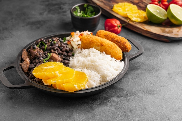 High angle tasty brazilian dish with orange Free Photo