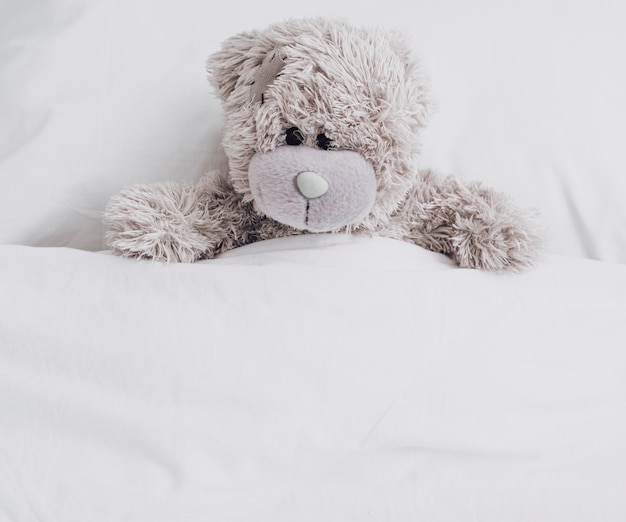 High angle teddy bear in bed Free Photo