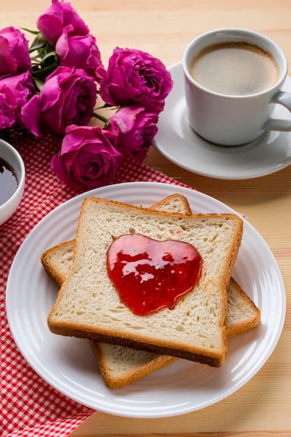 High angle of toast with jam and coffee Free Photo