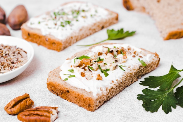 High angle of toast with spread and walnuts Free Photo