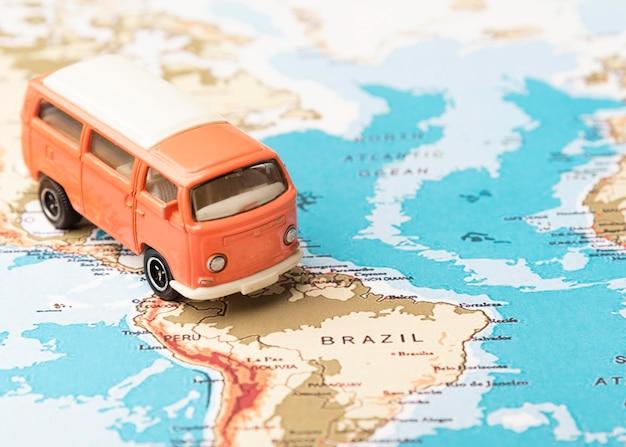High angle toy van on world map Free Photo
