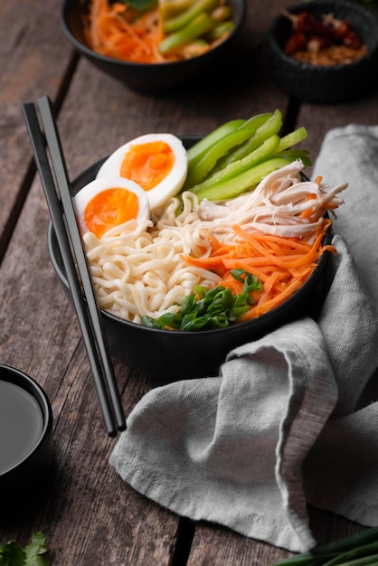High angle of traditional asian dish with chopsticks and noodles Premium Photo