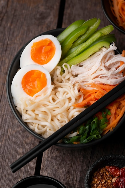 High angle of traditional asian dish with eggs and noodles Premium Photo