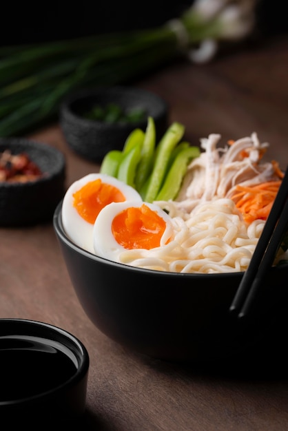 High angle of traditional asian dish with eggs in noodles Free Photo