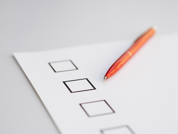 High angle uncompleted questionnaire Free Photo