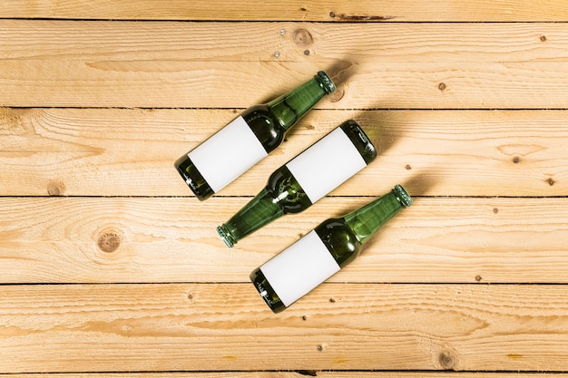 High angle view of alcoholic bottles on wooden surface Free Photo
