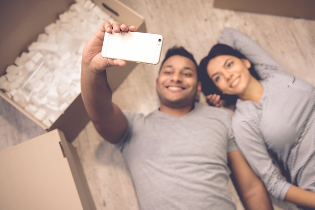High angle view of beautiful couple doing selfie Premium Photo
