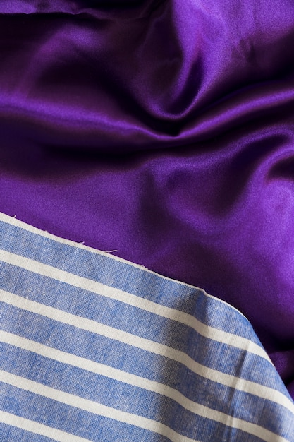 High angle view of blue plaid textile and smooth purple cloth Free Photo