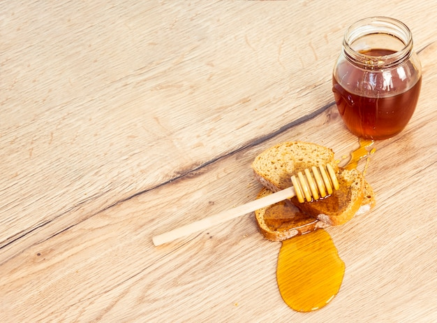 High angle view of bread and honey with honey dipper Free Photo