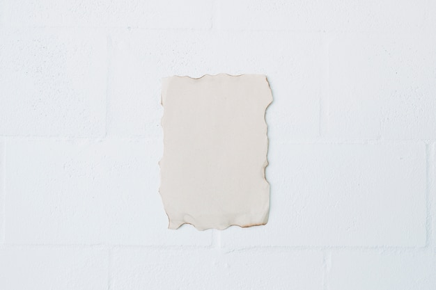 High angle view of burnt paper over white wall Free Photo