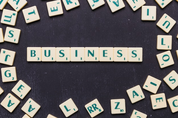 High angle view of business text on scrabble letters Free Photo