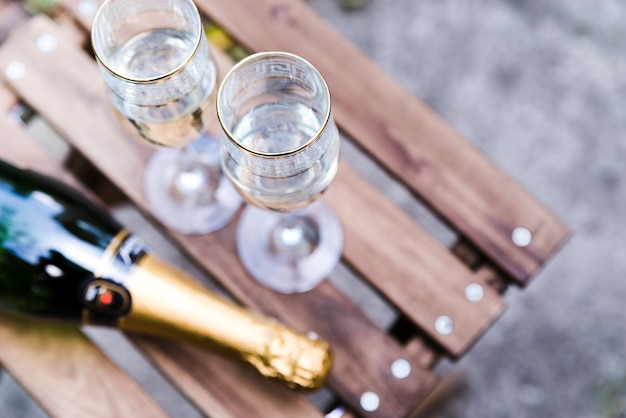 High angle view of champagne glass on wooden table Free Photo