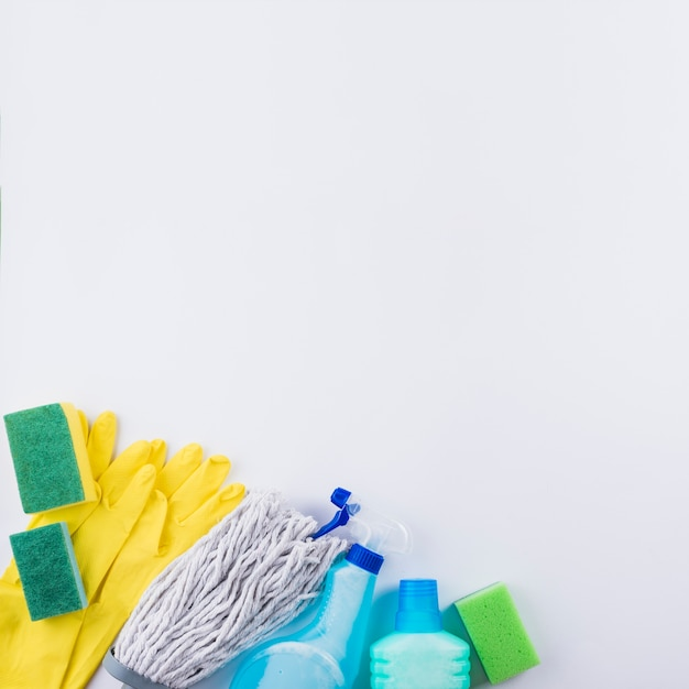 High angle view of cleaning products on grey background Free Photo