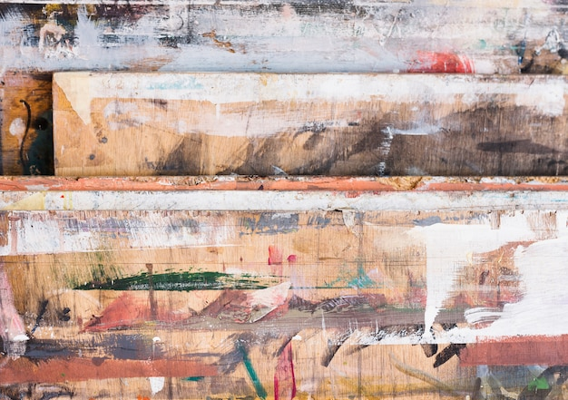 High angle view of colorful brushstroke on wooden textured Free Photo