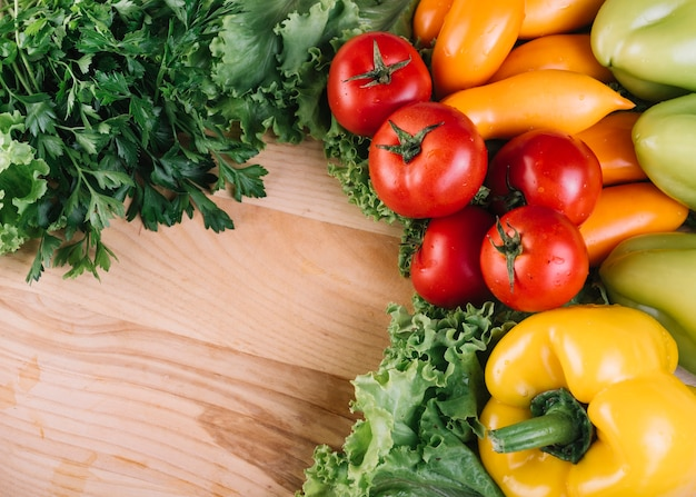 High angle view of colorful fresh vegetables on wooden background Free Photo