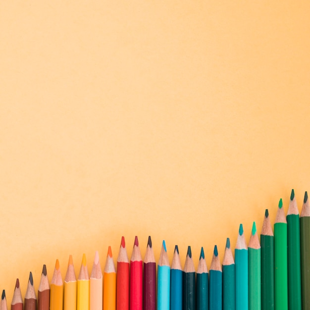 High angle view of colorful pencils over the colored background Free Photo