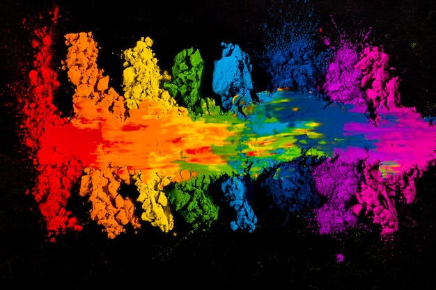 High angle view of colorful smudged indian holi color Free Photo