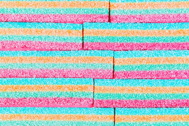 High angle view of colorful striped sugar candies Free Photo