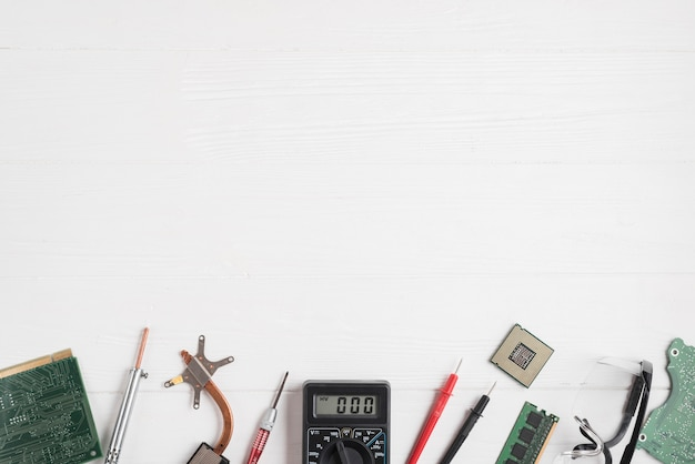 High angle view of computer parts and tools on wooden backdrop Free Photo