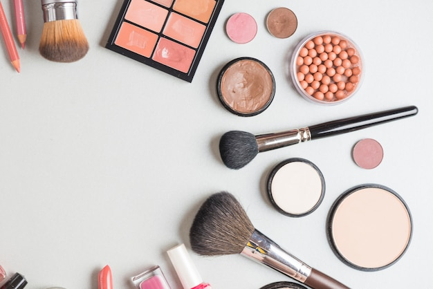 High angle view of cosmetic products on white backdrop Free Photo