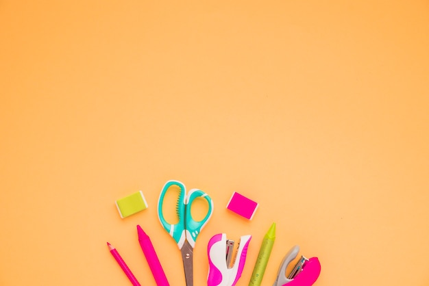 High angle view of craft supplies at the bottom of orange background Free Photo