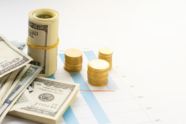 High angle view of currency on top of graph Free Photo