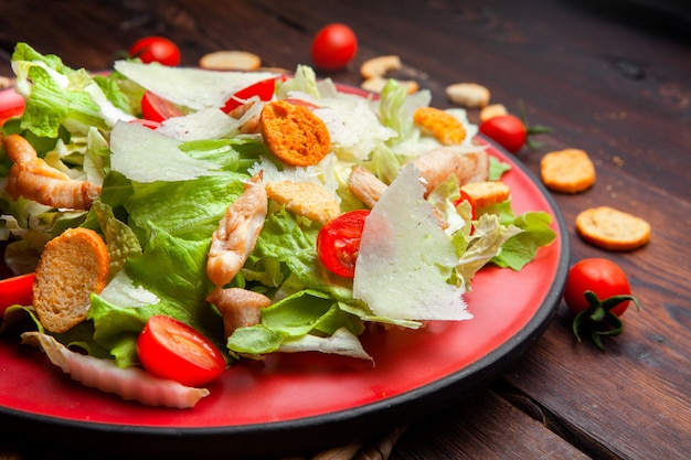 High angle view delicious salad in a plate on wooden background. horizontal Free Photo