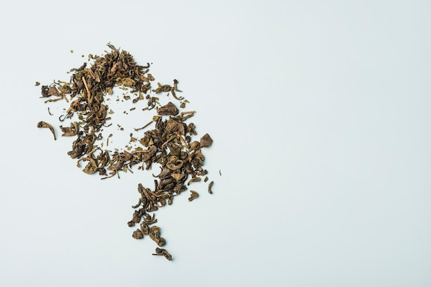 High angle view of dry flower petals on white backdrop Free Photo