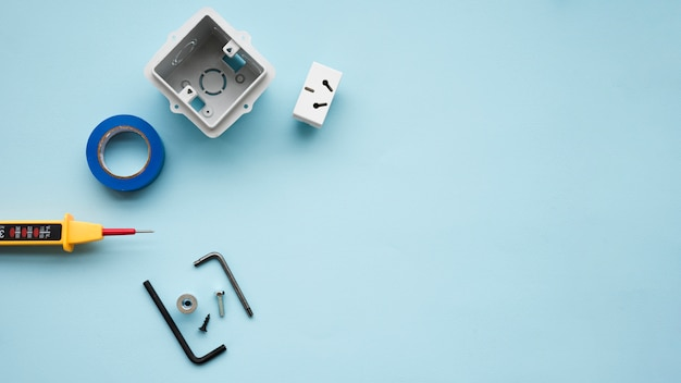 High angle view of electric equipment over blue backdrop Free Photo