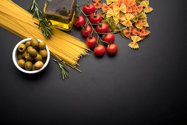 High angle view of fresh ingredients and raw italian pasta Free Photo