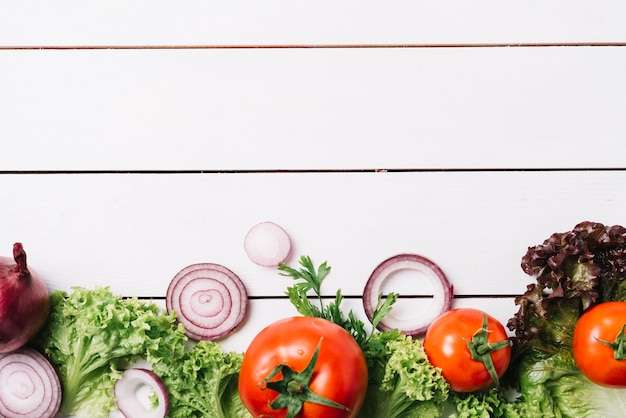 High angle view of fresh vegetables on wooden background Free Photo