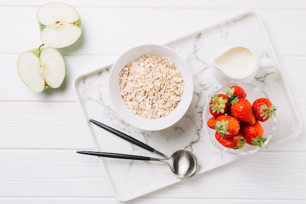 High angle view of healthy morning breakfast on white wooden table Free Photo