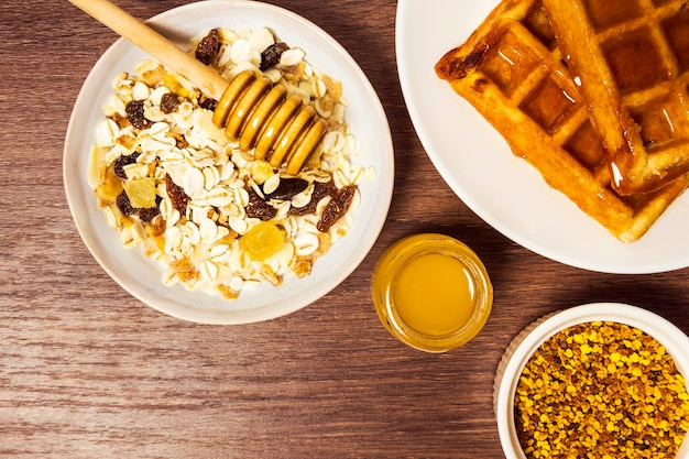High angle view of healthy oats with waffle and honey Free Photo