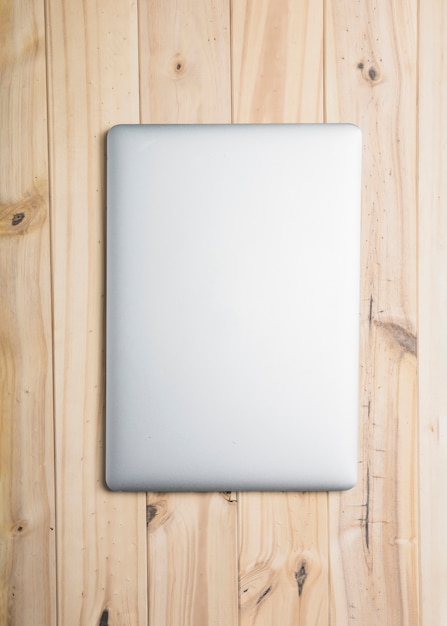 High angle view of a laptop on wooden backdrop Free Photo