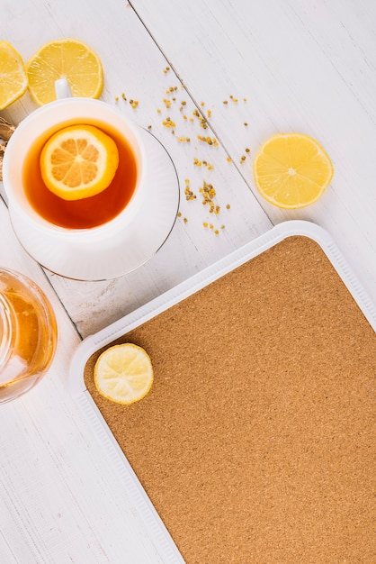High angle view of lemon tea on wooden surface Free Photo
