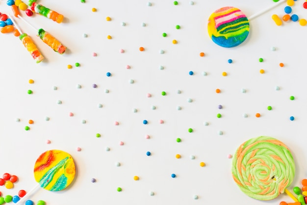 High angle view of lollipops and candies on white background Free Photo