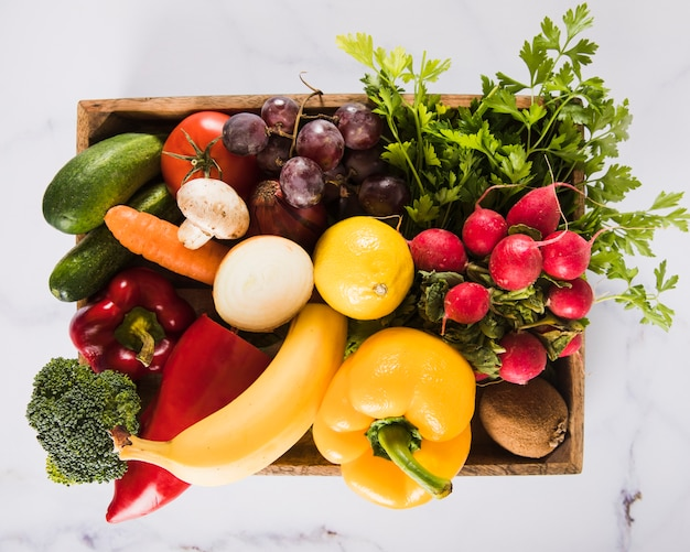 High angle view of many fresh vegetables in container Free Photo