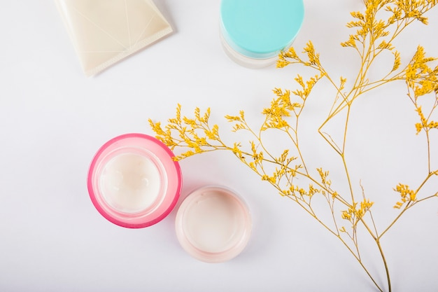 High angle view of nourishing cream on white surface Free Photo