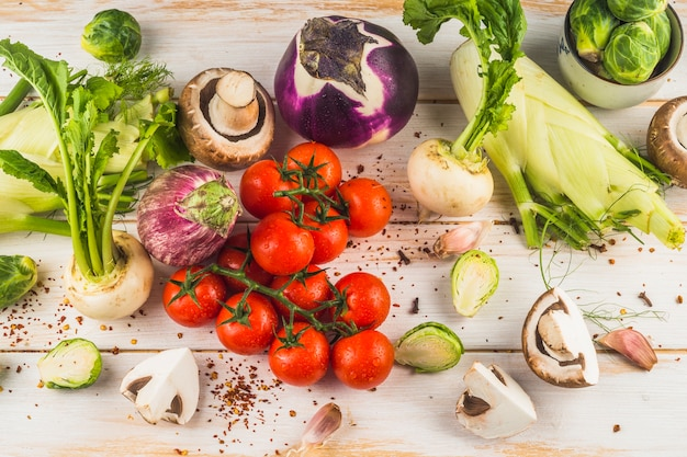 High angle view of raw vegetables on wooden surface Free Photo