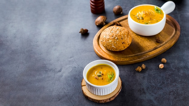 High angle view of squash soup on wooden board with copy space Free Photo