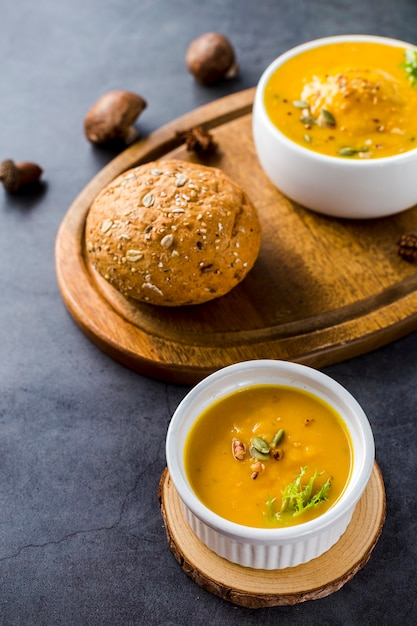 High angle view of squash soup on wooden board Free Photo