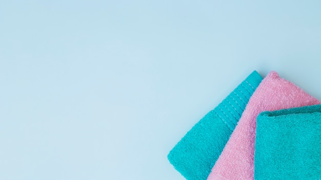 High angle view of three towels on blue background Free Photo