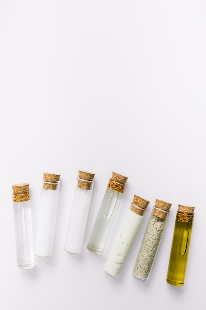 High angle view of various cosmetic test tubes on white background Free Photo