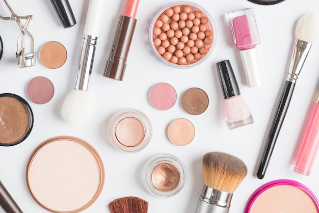 High angle view of various makeup products on white background Free Photo