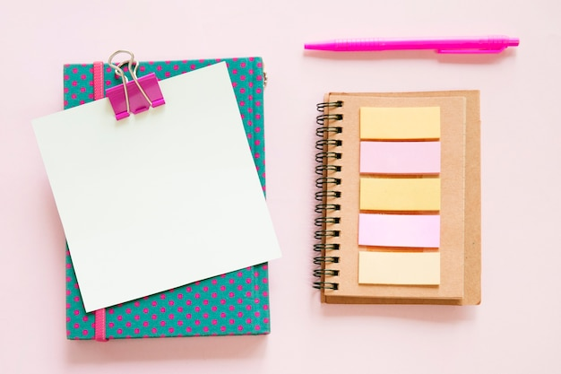 High angle view of various stationeries on pink background Free Photo