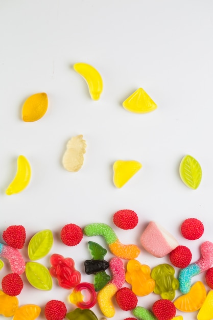 High angle view of various sweet candies on white background Free Photo