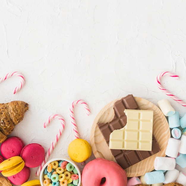 High angle view of various sweet foods on white background Free Photo