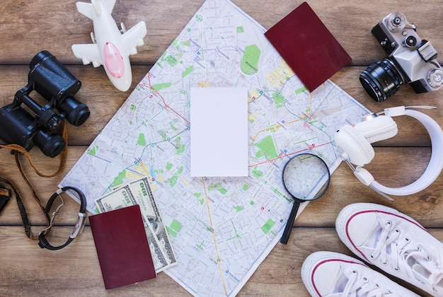 High angle view of various traveler accessories on wooden surface Free Photo